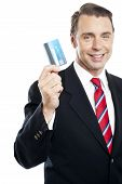 Business Representative Showing Credit Card