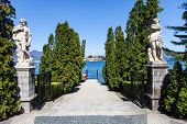 stock photo of lagos  - Luxury entrance to a small port in front of Isola Bella Lago Maggiore Italy - JPG