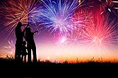 picture of boy girl shadow  - happy family standing on the hill and watching the fireworks - JPG