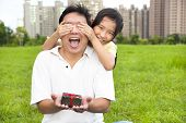 Surprised Father Holding Gift Box From Little Girl For Father's Day