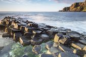 stock photo of volcanic  - The Giants Causeway are the result of an ancient volcanic activity North Ireland - JPG