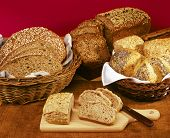 stock photo of bread rolls  - Still life with different kinds of whole grain bread - JPG