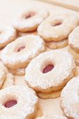picture of linzer  - Closeup of Traditional Linzer Cookies on Wooden Board  - JPG