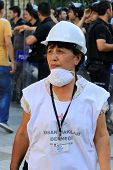Woman wearing white helmet and shirt