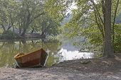 Rowboat Waiting By A Still Lake