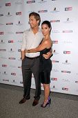 Eric Winter and Roselyn Sanchez at the Hollywood Reporter