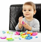 picture of molding clay  - Happy caucasian toddler boy playing with clay dough isolated on white background - JPG