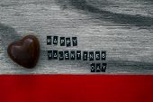 Valentines day choclate on wood background