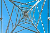 stock photo of electricity pylon  - Detail of electricity pylon against blue sky - JPG
