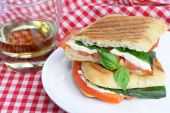 Panini Sandwich Of Basic, Mozzarella And Tomatoes.