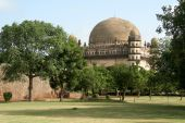 Gol Gumbaz Through Garden