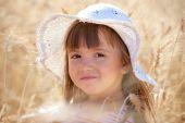 Lovely Girl Among Wheat Ears