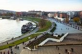 KRAKOW, POLAND - OCT 19, 2013: View of the embankment of Vistula River in the historic city center. Vistula is the longest river in Poland, at 1,047 kilometres (651 miles) in length.