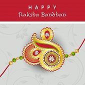 Beautiful rakhi design on floral decorated grey background on the occasion of Happy Raksha Bandhan.