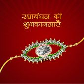 Beautiful rakhi on maroon background on the occasion of Happy Raksha Bandhan festival.