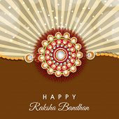 Beautiful rakhi on stylish brown background for the festival of Raksha Bandhan.