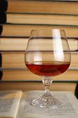 Glass Of Brandy On Books
