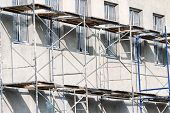 stock photo of scaffolding  - Scaffolding on a building used for renovation and construction - JPG