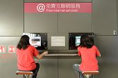 HONG KONG - APRIL 17: girls use free internet serveses on April 17, 2014 in Hong Kong. Hong Kong Int