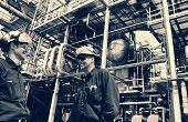 oil and gas workers inside large chemical refinery, oil and fuel petrochemical industries.