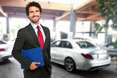 Handsome smiling car dealer portrait