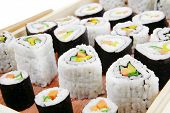 Maki Sushi and Nigiri - Maki Rolls and California rolls made of fresh raw Salmon, Tuna and Eel with
