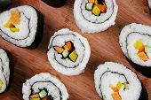 Japanese traditional Cuisine - Roll with Cucumber , Cream Cheese with raw Tuna and Salmon inside. on