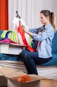 Woman Packing Her Clothes
