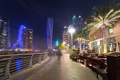 DUBAI, UAE - 31 MARCH 2014: Promenade in Dubai Marina at night, UAE. Dubai Marina is a district in D