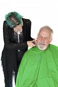 Profile view of a man about to get a shave from a female barber at a barber shop. isolated on white with room for your text