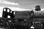 foto of landfill  - Abandoned old rusty train in black and white - JPG