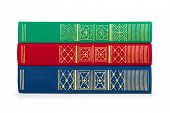 Stack Of Vintage Red, Green And Blue Book On White Isolation