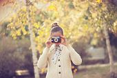 Hipster Girl Shooting On Film Camera Outdoor