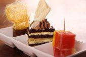 stock photo of chocolate fudge  - Three beautiful delicious gourmet desserts on a white plate - JPG