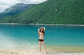 Young Happy Girl Enjoying Beauty World. Enjoyment Concept. Free Woman Adult Resting On Beach. Monten
