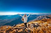 Happy Freedom Woman With Opened Arms, On The Top Of A Mountain, Enjoying Bliss Travel Holidays Vacat