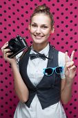 Happy Smiling Stylish Teenager With Vintage Camera Showing Victory And Peace Gesture