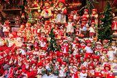 stock photo of stall  - Christmas dolls at a Christmas market stall - JPG