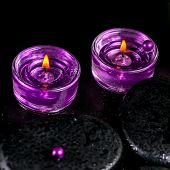 Spa Still Life Of Zen Basalt Stones With Bead, Drops And  Lilac Candles,  Closeup