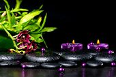 Beautiful Spa Setting Of Zen Basalt Stones With Drops, Lilac Candles, Beads And Bamboo, Closeup