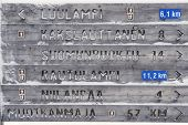 pic of laplander  - Wooden directions sign in winter in Finnish Lapland - JPG