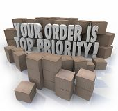 Your Order is Top Priority 3d words surrounded by cardboard boxes in a warehouse, products about to be shipped out to you in fulfillment
