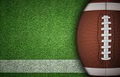 pic of football  - American football ball on green grass and white line - JPG