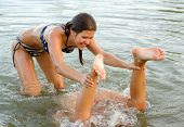 Teenage Girls Playing In The Water
