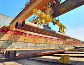 Loading Pipes With Bridge Crane