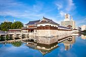 Entrance at Hiroshima castle with wall and water pond to protect from the enemy. Hiroshima, Japan.