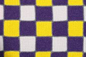 Homemade knitted fabric in a patchwork style texture background
