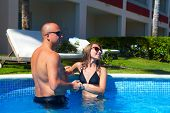 Loving Couple In Pool