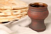 stock photo of covenant  - Chalice with red wine and pita bread - JPG