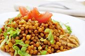 closeup of a plate with refreshing lentil salad, in a set table